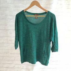 Green 3/4 sleeve top Has black accents in the top Juniper Ln Tops Tees - Short Sleeve