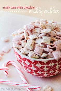Candy cane white chocolate muddy buddies from The Baker Upstairs. This Christmas snack mix is totally addicting, and so delicious! www.thebakerupstairs.com