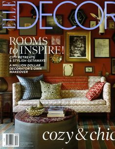 @ELLE DECOR  December2012  The living room of John Robshaw's New York apartment, which he designed in collaboration with Sara Bengur. A John Derian sofa is upholstered in Lanka Oyster fabric and topped with his pillows, and the bone-inlay side tables hold mango-wood lamps fitted with shades by Robshaw; a mask from an Indian market, Turkish calligraphy mirrors, and a wood cow sculpture adorn the wall…