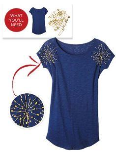 camiseta  decorada con imperdibles