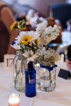 I think I found our centerpiece holder things! ...the Bawls bottles, not the Mason jars. Plus they're TARDIS blue already!