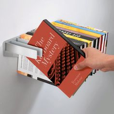 This seems like it would ruin the spines of the books. However, if it does not cause a bookish type's nightmare I like the idea.