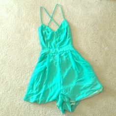 Mint Lulu's romper Beautiful gently worn light teal romper. Open strappy back with zipper shorts and pockets! Lulu's Pants Jumpsuits & Rompers