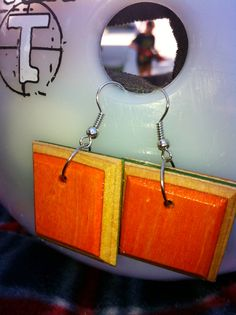 My New recycled skateboard earrings xxx skate decks have such beautiful colors just waiting to be revealed!!!