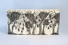 """Eunice Botes Ceramics """"Lane of trees with Finch nests"""" - White porcelain with sprigs and sqraffito."""