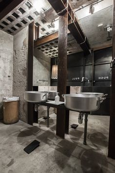 La Menagere (Florence, Italy), q-bic. exposed concrete walls, tin hand basins, exposed metal beams