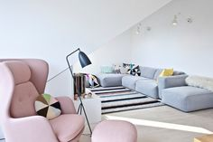 Pantone Color of the Year | Rose Quartz and Serenity | Scandinavian style living room decor | pink chair and blue couch | striped rug | white walls | cute living room decor ideas