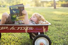 2 year old, books, radio flyer, 2 year old photography, sun flare photography, gina hancock photography