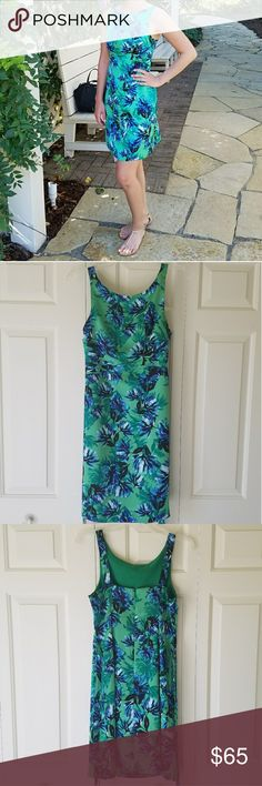 Banana Republic floral dress Beautiful dress!  Light, Kelly and forest greens, royal blue, bits of black and white.  Ties in a bow at the back.  100% polyester, machine washable. Worn once to a Sunday morning wedding at a botanical garden. Banana Republic Dresses Midi