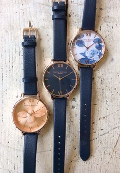 Olivia Burton watches. Navy & rose moulded bee, navy faced big dial, painterly prints in navy.