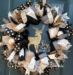 Joy to the World! This gold wreath celebrates the birth of the King with an elegant but rustic feel. The wood sign is centered in three different colors of deco mesh, Cream Gold Sparkle Wide Foil Deluxe Poly Deco, Black Sparkle Wide Foil Poly Deco Mesh and a Cream with Gold Foil Deco Mesh. Five different coordinating patters of wire ribbon are layered throughout this handcrafted wreath giving a FULL look. Glitter gold picks and ornaments draw your attention to this one of a kind wreath…