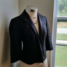COLDWATER CREEK. ...BLACK OPEN FRONT BLAZER. EXCELLENT CONDITION. .NEW LISTING...GORGEOUS DESIGN THROUGHOUT. ..better in person...true to its size and color ...2 pic shows up close the nice detail material ..it has no flaws...it opens up front ...it doesn't have no buttons or zipper....SHELL IS 100% SILK.. LINING ...IS 100%POLYESTER. ..better on person. .... ...... Coldwater Creek Jackets & Coats Blazers