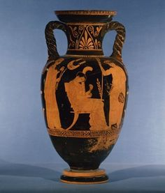 Pottery: red-figured amphora showing a variety of musical instruments. Mousaios, holding a lyre, and Melousa (Melelosa in inscription) a pair of pipes, listen while Terpsichore plays the harp. In the background hangs a kithara.  Inscribed.