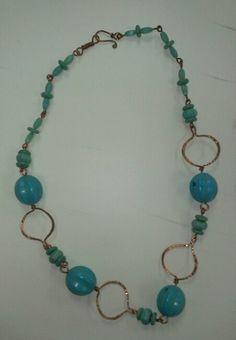 Blue ceramic necklace by Nancy S.