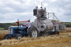 Fordson Super Major Tractor with a Claas Super Combine Trailed Harvester.