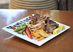 Mix #grill platter for two persons. beef burgers, lamb chops, #chicken, pork chop with potatoes and grilled vegetables #alanamenu For Meat lovers of #alana...