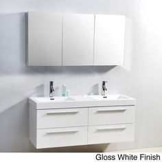 The Finley 54-inch double sink vanity set is equipped with four soft closing drawers, a gorgeous poly-marble countertop/basin, and two PS-103 single-hole faucets. This lovely vanity set adds modern style to any space.