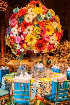 This gigantic rainbow daisy centerpiece from our friends at Bronze Budget Bride is proof that bright, colorful weddings are in!