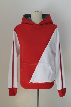 Ready for an adventure! This cosplay hoodie was inspired by the Pokemon Go trainer avatar. It is a pullover style sweater with contrasting red and white colors front and back. The sleeves are long wit