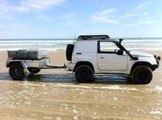 Nice Sidekick / Tracker and compact Tent Topped camping trailer looking for a place to camp at the beach.