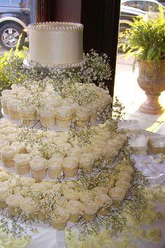 Rustic wedding cupcake display. @ http://JuliesCafeBakery.com #cupcakes #recipe #cakes #weddingcakes