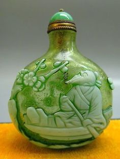 Peking Glass Carved Elder on Boat Pattern Snuff Bottle.: