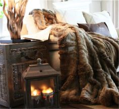 love these faux fur throws...if I could just keep my cats off them