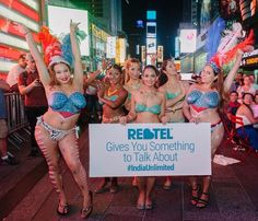 At the very end, it was revealed that they were promoting an international calling plan. | Today's Dose Of WTF: Four Topless Women Did Bollywood Dancing At Times Square Wearing Only Body Paint
