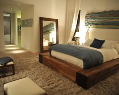 Rustic Wood Platform Bed, cozy rug... love the vibe of this room