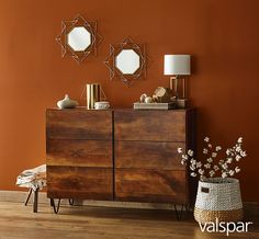 Create a warm welcome in your entry or any living space with this down-to-earth terra cotta. Bring in brass accents and pops of white to contrast the richness of the red. It pairs well with natural wood floors and woven materials too. Paint Color: Valspar Autumn Russet at Lowe's, Valspar Red Maple at Ace and Independent Retailers. https://www.askval.com/ColorsOfTheYearLanding/Baked-Terra-Cotta