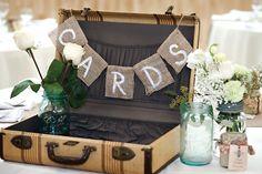 Vintage suitcase card box with burlap garland.    Photography by Lisa Klassen.