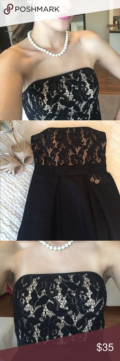 Black Maggy London bubble dress Love the cute bow detail on this black, strapless bubble dress! Maggy London Dresses Strapless