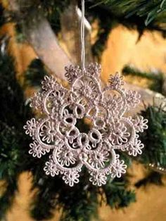 Crochet snowflake - Reminds me of the lace on my sister's wedding dress.