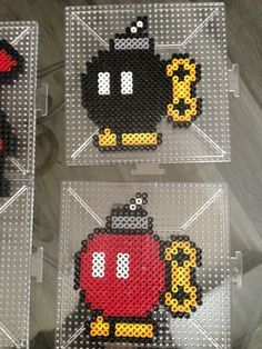 Two Bob-ombs Mario perler beads by S Sharda