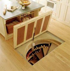 Floor hatch spiral stairs to wine cellar.... someday.