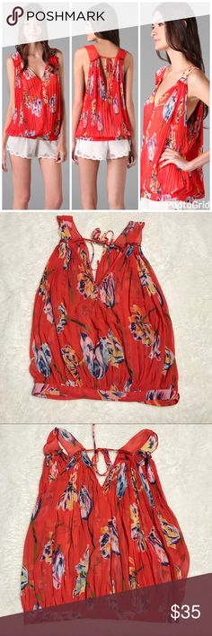 Free people hibiscus floral sheer top size small Excellent condition free People size small sheer hibiscus floral Sleeveless Blouse. Beautiful floral print on a vibrant red background. Pretty pleats and tie back give it a girly feel. Banded buttoned hem. Free People Tops