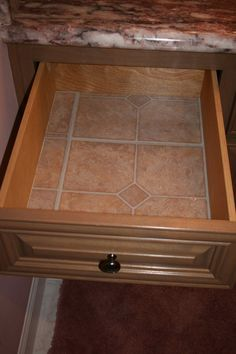 I use linoleum floor tiles instead of Contact paper to line drawers and cupboards. I cut the tiles with kitchen scissors. They are very durable, easy to clean and only cost about $.33 each at Lowes or Home Depot.