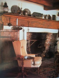 what if you could make one ugly large no-mantle fireplaces into a primitive fireplace? Add mantle, paint color, cupboards, beams, etc. Primitive Homes, Primitive Fireplace, Primitive Living Room, Primitive Antiques, Primitive Decor, Primitive Furniture, Fireplace Wall, Country Farmhouse Decor, Country Primitive