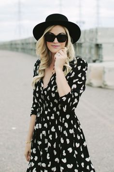 Love the feminine printed dress with the edgy hat!