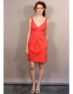 A playful orange Jenny Yoo dress perfect for a summer wedding