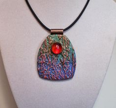 Texture pendant in blue gree red gold with glass gem accent polymer clay | by Sweet2Spicy