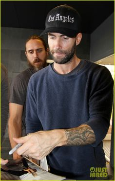Adam Levine Leaves His Heart in Los Angeles: Photo Adam Levine shows some love for his hometown Los Angeles while arriving on a flight at Narita International Airport on Tuesday (September in Tokyo, Japan. Adam Levine Style, My Baby Daddy, Cool Bands, Eye Candy, 18th, Mens Tops, Leaves, Celebrities, Brazil
