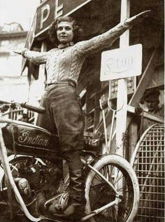 Gorgeous sepia photo of a woman on an Indian motorcycle