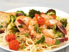 Sheet-Pan Shrimp Scampi with Broccoli and Tomatoes | Shrimp Scampi, a no-fail family favorite, has legitimately never been easier—oh, and we upgraded it with veggies, too. All the flavorful magic of this recipe happens on the sheet pan: Roasting shrimp, cooking broccoli and tomatoes, and creating a vibrantly mouthwatering lemon-butter sauce. Once you pull all of the saucy scampi goodness from the oven, simply serve ove