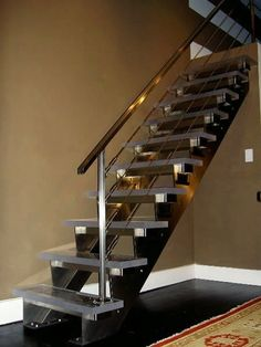 Custom Made stainless steel /glass stairs by Laidman Fabrication