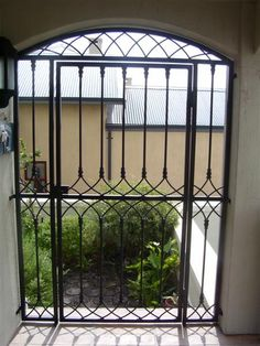 Wrought Iron Gate - Pedestrian  www.realsec.co.za Front Door With Screen, Front Yard Fence, Front Gates, Wrought Iron Gate Designs, Wrought Iron Gates, House Gate Design, Gate House, Wrought Iron Stair Railing, Railings