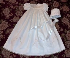 """Christening Gown and Cap by Karen Ann Betts: the pattern – """"Sandy's Joy"""" –in a Creative Expressions magazine (#9). It's not quite heirloom, but I used some heirloom techniques – Madeira appliqué, hem with pin stitching, lace joining, and French seams. No raw edges show anywhere!"""