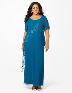 Our elegant gown is just the extra-special piece you need for your special occasions. We designed it to look like two separate styles, but they are actually expertly stitched together for easy, all-in-one wear. Floral scrolling beadwork cascades down into an angle on the top. Pull-on style. Scoop neckline. Short sleeves. Bust darts. Chiffon draping ties. Catherines plus size dresses are expertly designed to flatter your figure. catherines.com