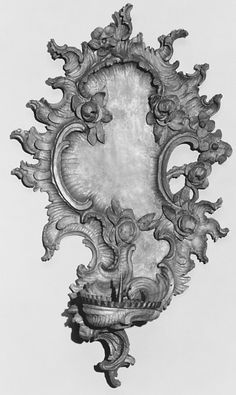 Pair of single-light wall brackets ca. 1750, German. Medium: Carved, painted and gilded wood Dimensions: Each 22 x 12-1/2 x 6 in. (55.9 x 31.8 x 15.2 cm)