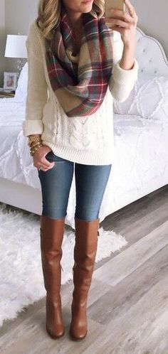 Cable knit sweater, plaid blanket scarf, & riding boots.